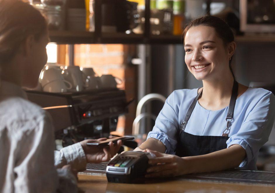 woman handing credit