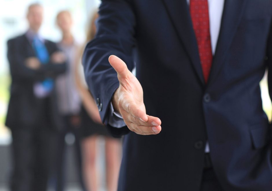 businessman holding up